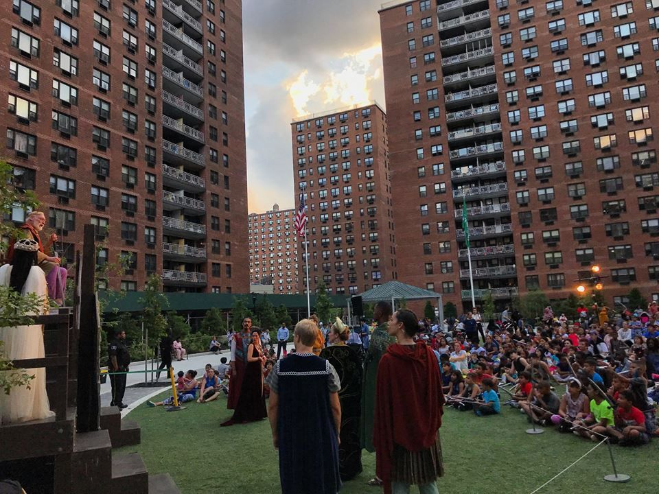 People gathered at the Center Courtyard, LeFrak City apartments watching Shakespeare in the Park
