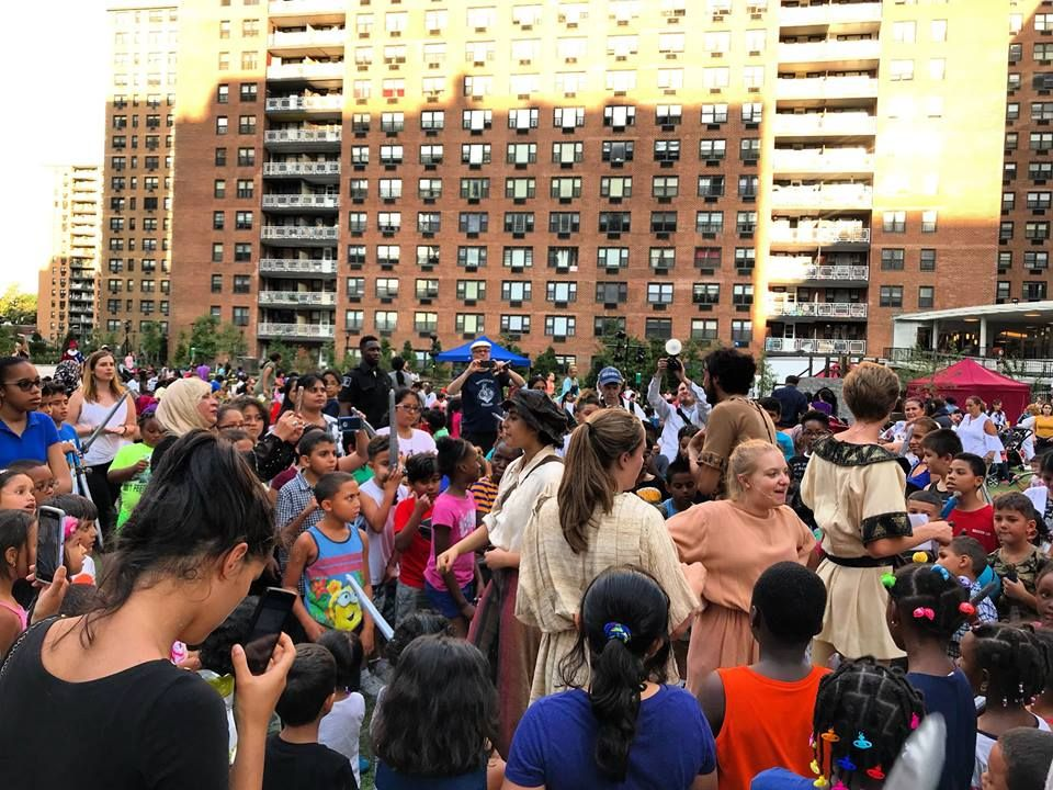 Children enjoying LeFrak City's Shakespeare in the Park