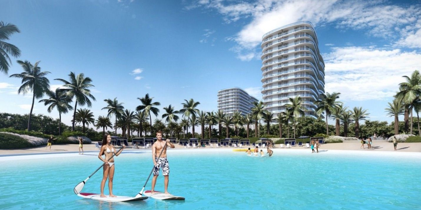Couple Paddle-Boarding on the Laguna Solé at the Shoreline at Solé Mia Apartments in North Miami