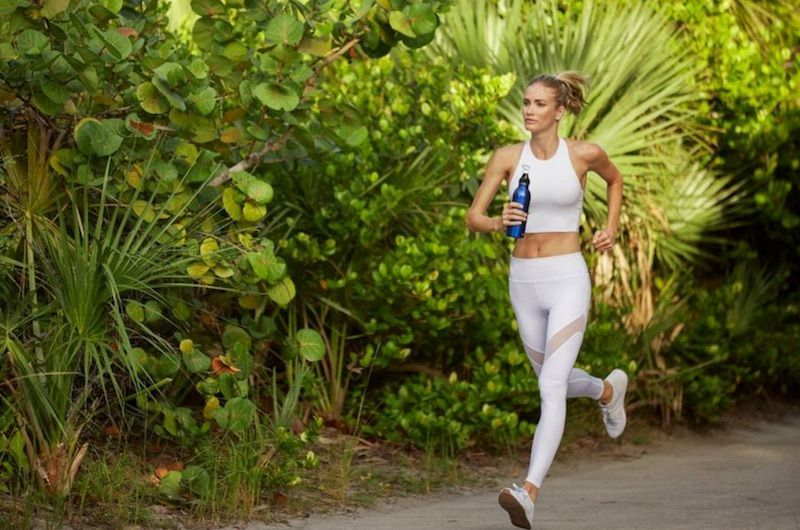 Woman Running along the Running Trails near the Shoreline at Solé Mia Apartments in North Miami