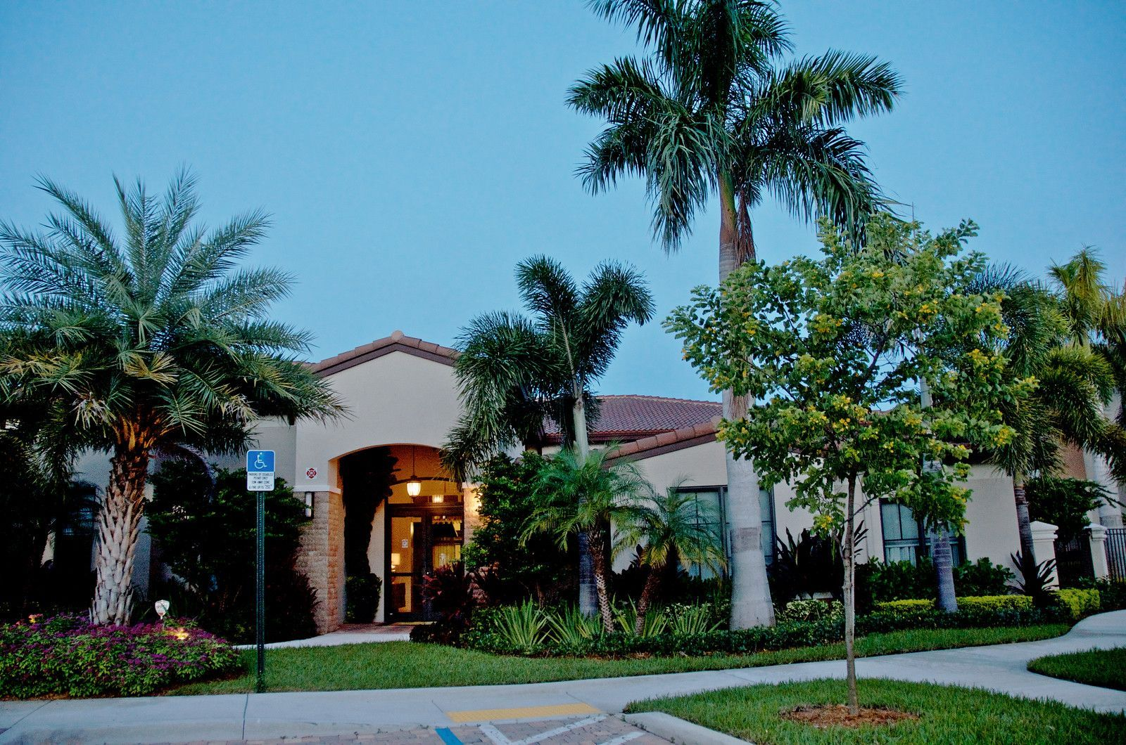 clubhouse front entrance with palm trees