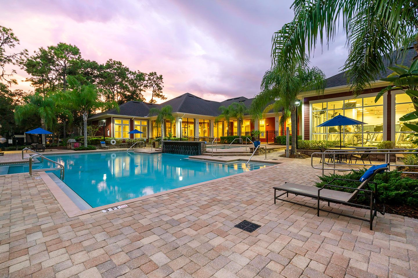 Large swimming pool and loungers at dusk