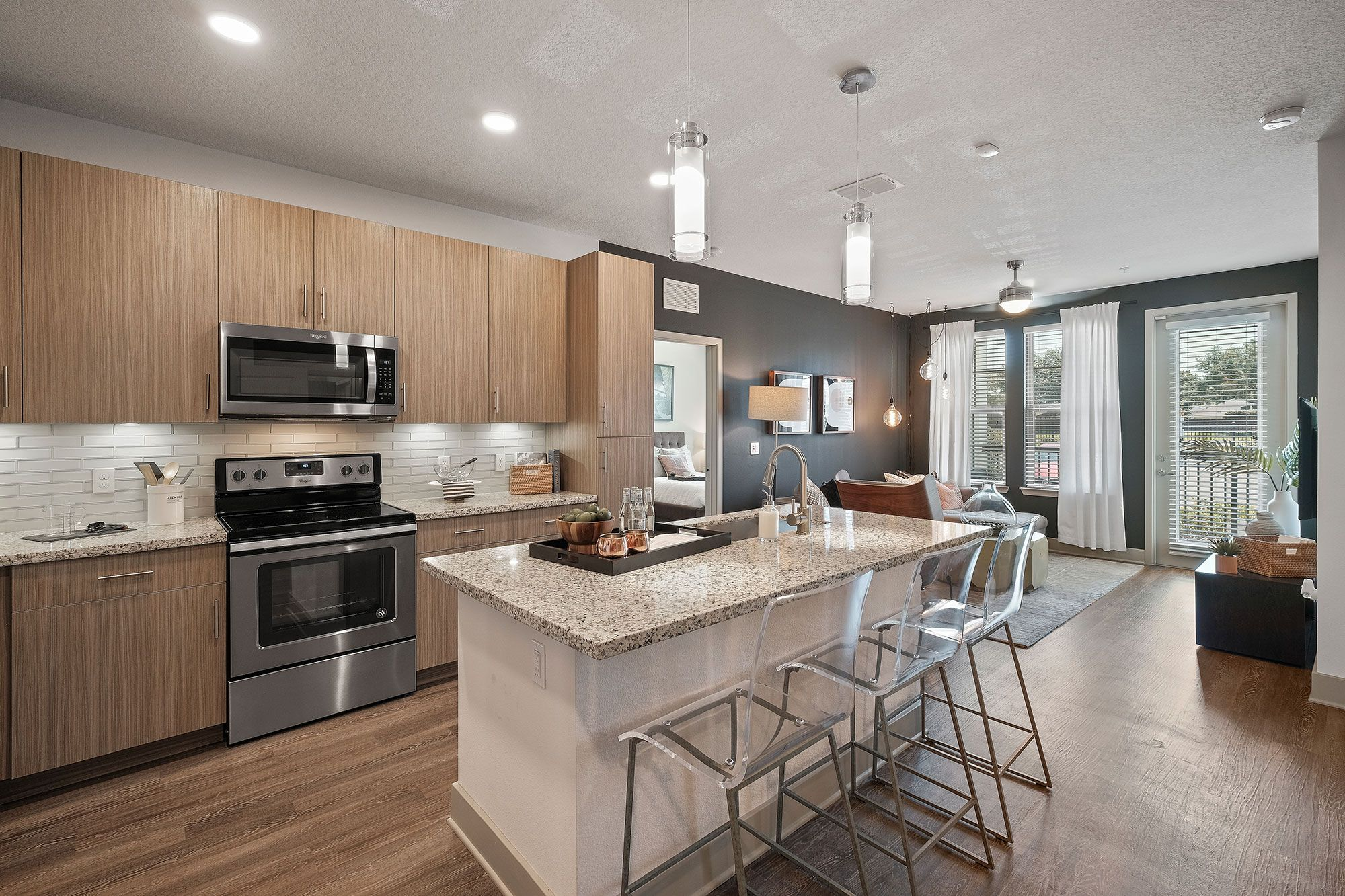 Apartment kitchen with island and granite countertops