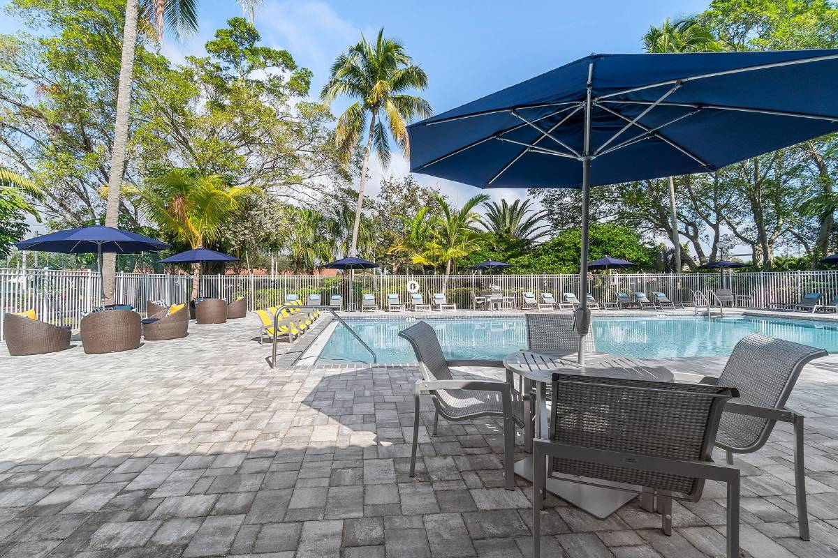 Poolside tables and umbrellas