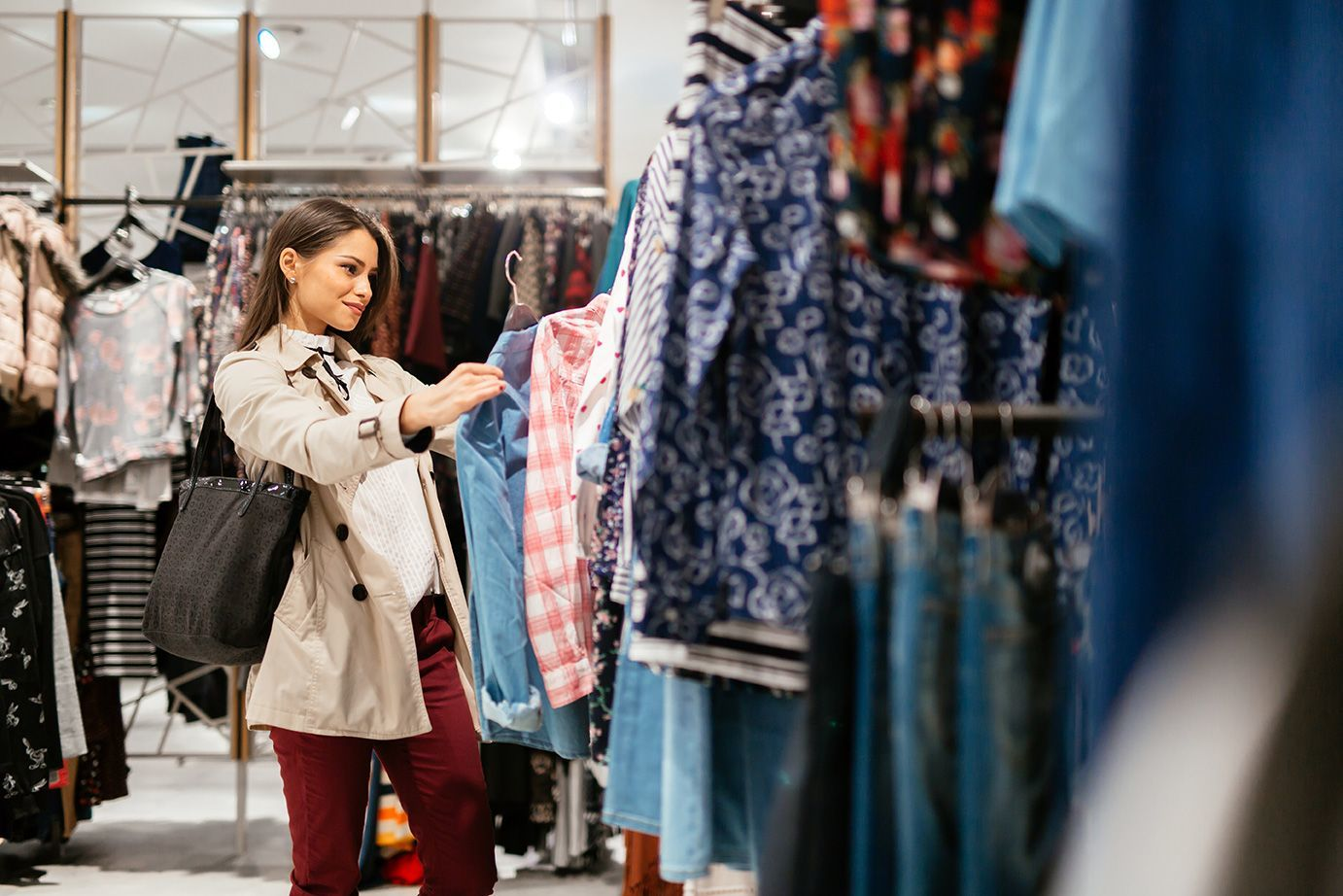 Woman looking at clothes in store